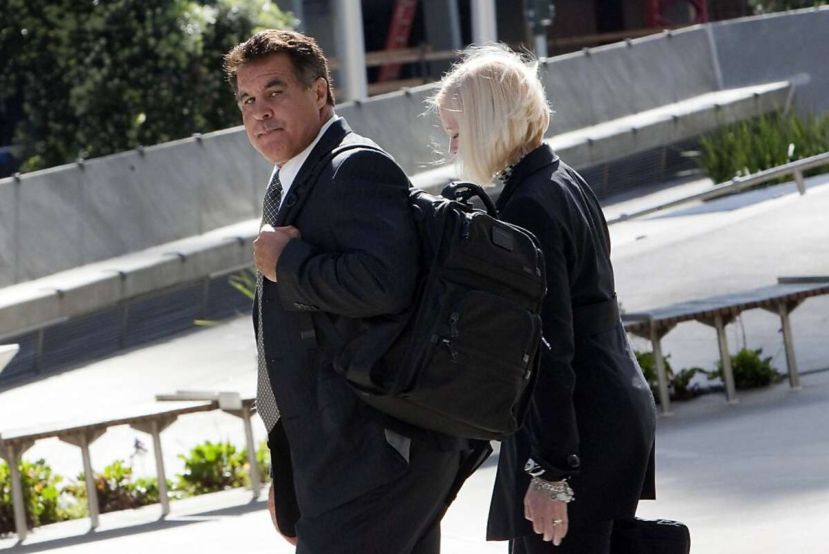 Stan Conte, the former San Francisco Giants' trainer, leaves the Phillip Burton Federal Building and United States Court House with an unidentified woman after testifying in the Barry Bonds pergery trial on March 28, 2011 in San Francisco, Calif. Photograph by David Paul Morris/Special to the Chronicle