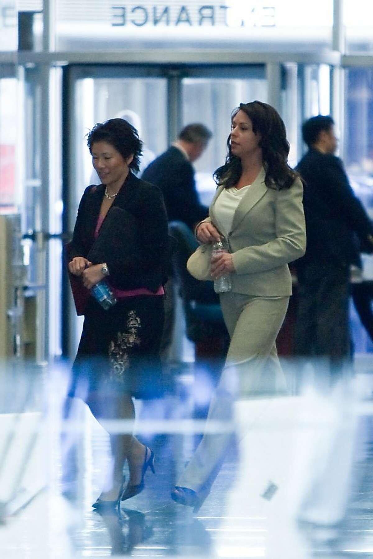 Kimberly Bell, (R) the former mistress of Barry Bonds leaves the Phillip Burton Federal Building and United States Court House with an unidentified woman after testifying in the Barry Bonds perjury trial on March 28, 2011 in San Francisco, Calif.