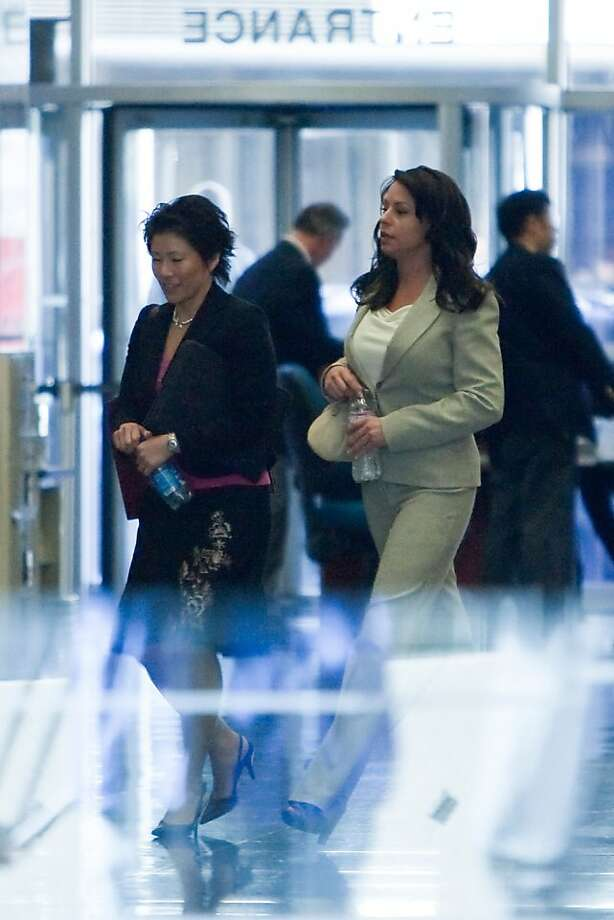 Kimberly Bell, (R) the former mistress of Barry Bonds leaves the Phillip Burton Federal Building and United States Court House with an unidentified woman after testifying in the Barry Bonds perjury trial on March 28, 2011 in San Francisco, Calif. Photo: David Paul Morris, Special To The Chronicle