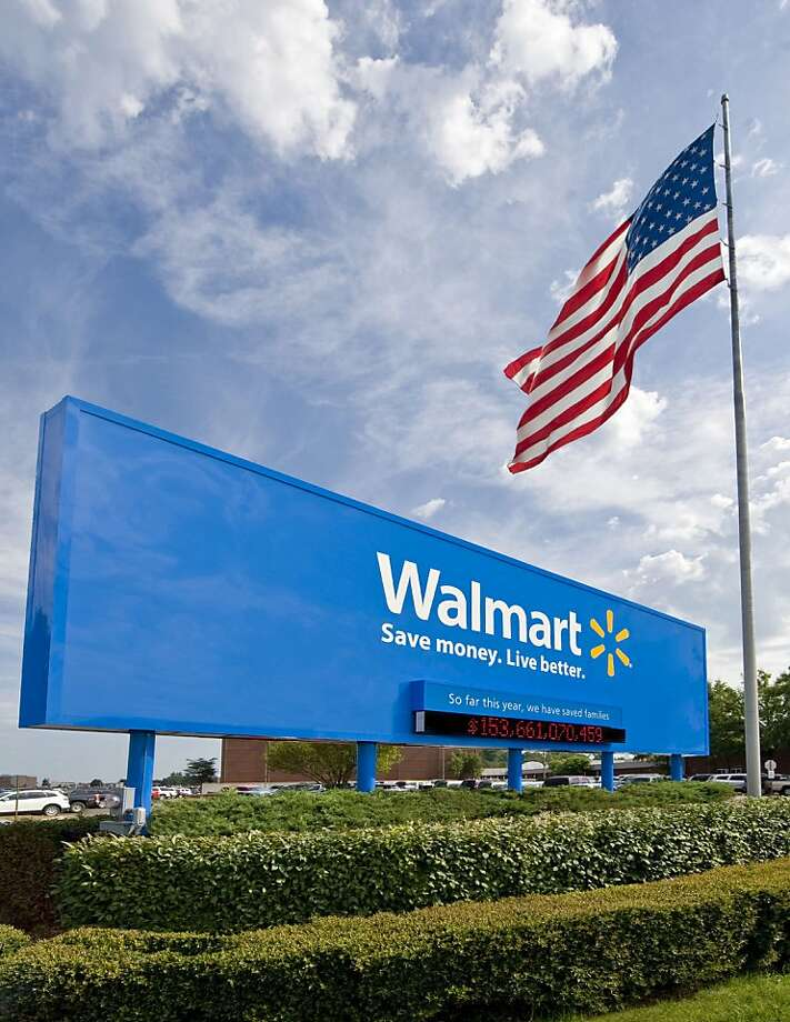 This undated file photo provided by Wal-Mart Stores Inc., shows the company's sign in front of their Bentonville, Ark., headquarters. Wal-Mart Stores Inc. announced a program Thursday, June 3, 2010, in which its workers can receive college credit from the online American Public University and receive a tuition discount from the school. Photo: Wal-Mart, AP