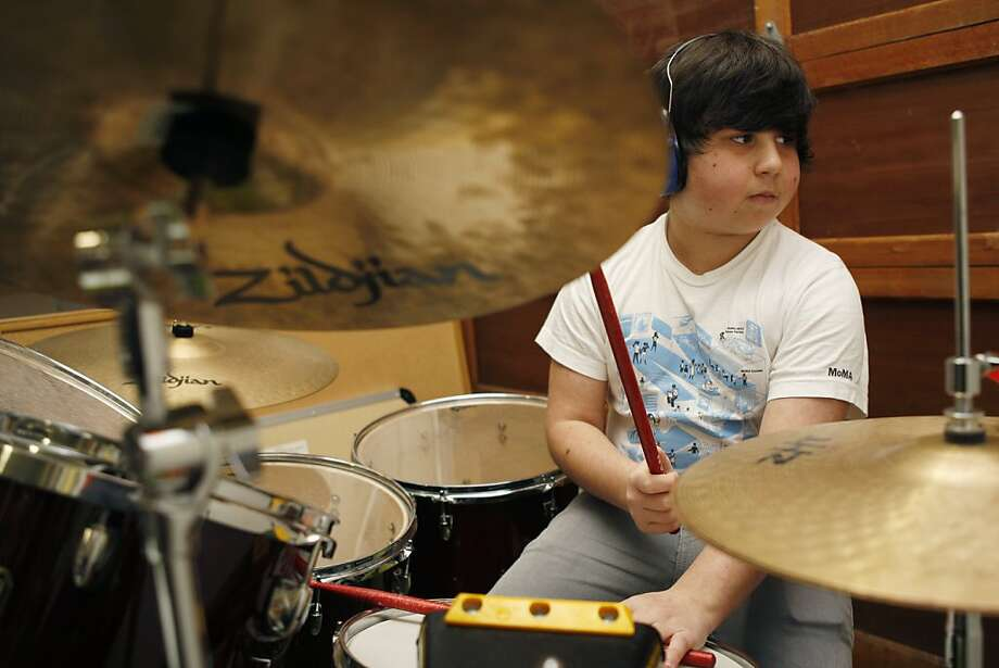 Noah Hornik plays the drums at his home in Palo Alto Calif, on Thursday, March 24, 2011. The 13-year-old Hornik has organized a benefit concert to be held at the Great American Music Hall. Photo: Alex Washburn, The Chronicle