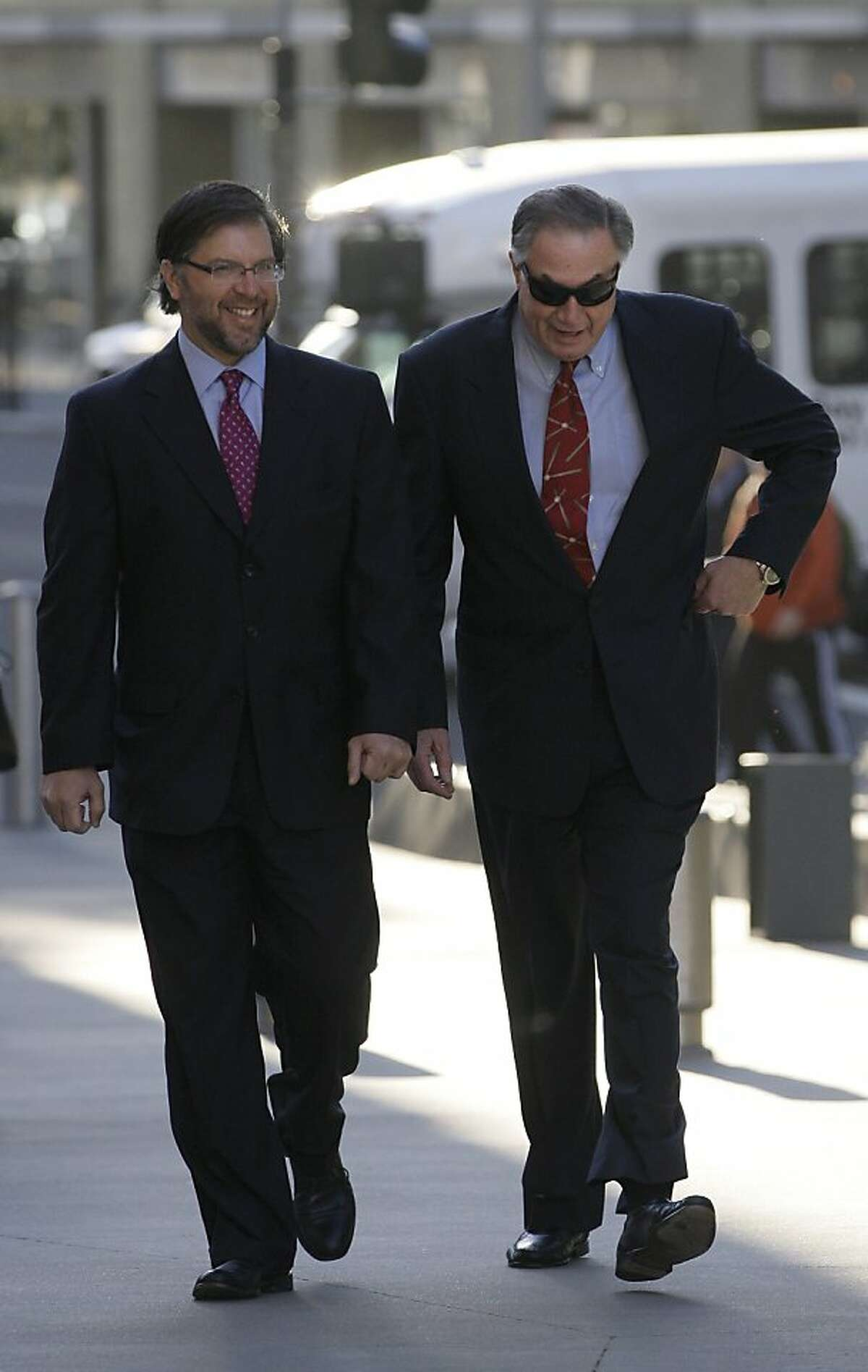 San Francisco Giants clubhouse manager Mike Murphy, right, arrives at federal court for the criminal trial of former baseball player Barry Bonds in San Francisco, Monday, March 28, 2011.