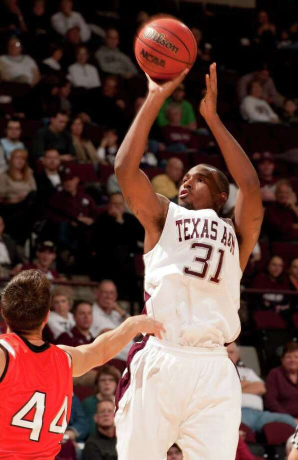 Texas A&M's Elston Turner (31) shoots over Sam Houston State's Konner Tucker (44) during the second half of an NCAA college basketball game, Wednesday, Dec. 7, 2011, in College Station, Texas. Texas A&M defeated Sam Houston State 64-37. (AP Photo/Dave Einsel) Photo: Dave Einsel / FR43584 AP