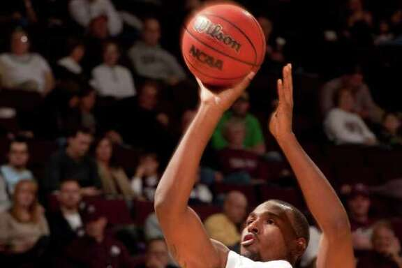 Texas A&M's Elston Turner (31) shoots over Sam Houston State's Konner Tucker (44) during the second half of an NCAA college basketball game, Wednesday, Dec. 7, 2011, in College Station, Texas. Texas A&M defeated Sam Houston State 64-37. (AP Photo/Dave Einsel)