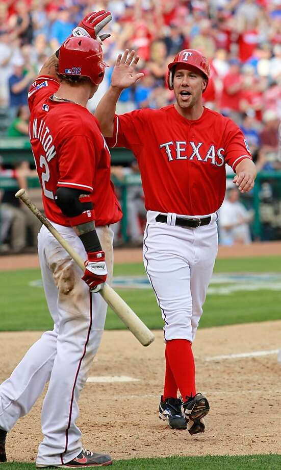 ARLINGTON, TX - APRIL 01:  David Murphy #7 of the Texas Rangers celebrates with Josh Hamilton #32 of the Texas Rangers after Hamilton hit the game winning RBI double in the bottom of the eighth inning against the Boston Red Sox on Opening Day at Rangers Ballpark in Arlington on April 1, 2011 in Arlington, Texas. Photo: Tom Pennington, Getty Images