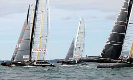 Four out of a newly announced 15 America's Cup teams shown here training heavily in 45-foot catamarans on Hauraki Gulf near Auckland.