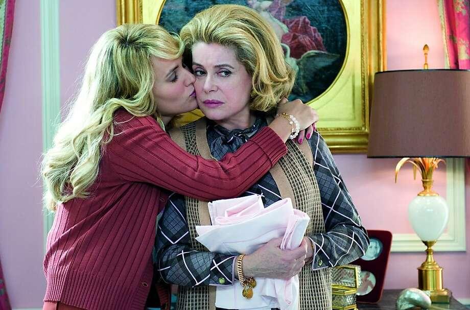 Joelle (Judith Godrche) and Suzanne Pujol (Catherine Deneuve) in Potiche. Photo: Courtesy Of Music Box Films