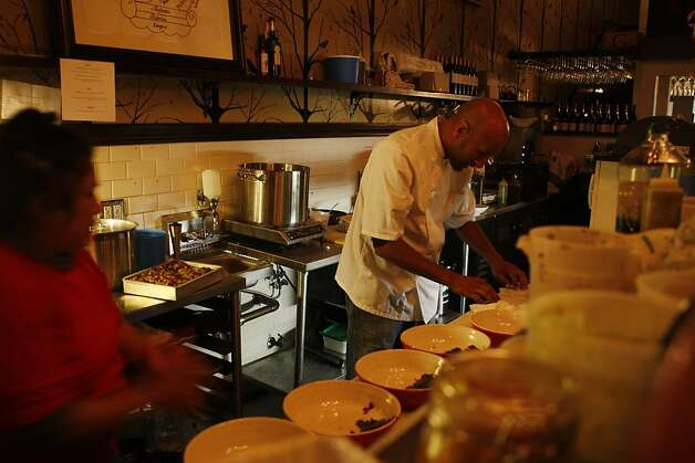 Eskender Aseged prepares food behind the counter at the restaurant Radio Africa and Kitchen at The Corner in San Francisco Calif, on Friday, Feb. 25, 2011. Photo: Alex Washburn, The Chronicle