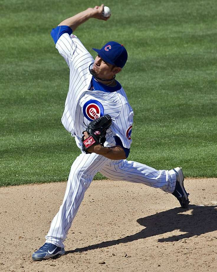 Chicago Cubs pitcher Matt Garza delivers a pitch against the Chicago White Sox during the second inning of a spring training baseball game Thursday, March 24, 2011, at HoHoKam Park in Mesa, Ariz. Photo: Matt York, AP