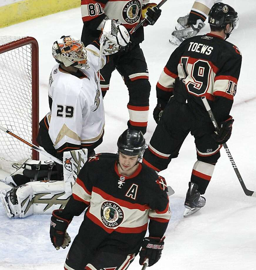 Anaheim Ducks goalie Ray Emery, left, celebrates his team's 2-1 win over the Chicago Blackhawks, as Chicago Blackhawks' Jonathan Toews, (19) and Brent Seabrook, bottom skate away, after their NHL hockey game, Saturday, March 26, 2011 in Chicago. Photo: Charles Rex Arbogast, AP