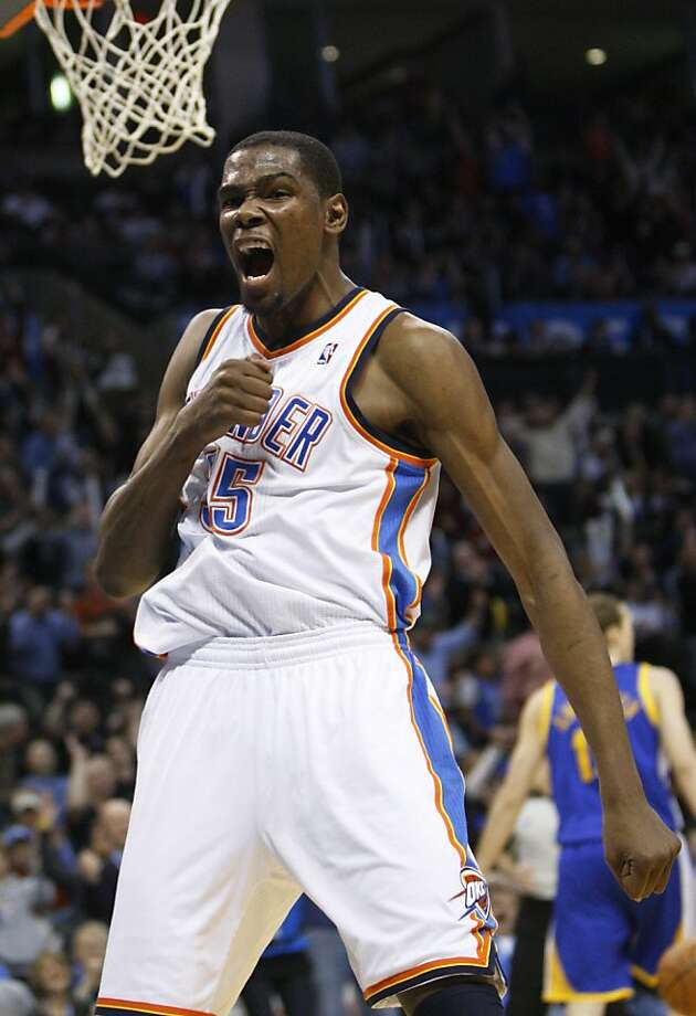 Oklahoma City Thunder forward Kevin Durant reacts after a dunk against the Golden State Warriors in the fourth quarter of an NBA basketball game in Oklahoma City, Tuesday, March 29, 2011. Oklahoma City won 115-114 in overtime. AP Photo/Sue Ogrocki) Photo: Sue Ogrocki, AP