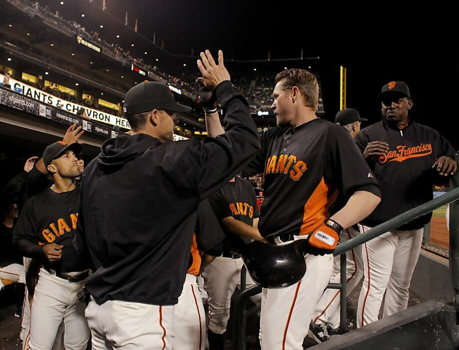 San Francisco Giants gather to congratulate Aubrey Huff after he hits a home run in the fifth inning against the Oakland Athletics in an exhibition game, Monday March 28, 2011, at AT&T PArk in San Francisco, Calif. Photo: Lacy Atkins, The Chronicle