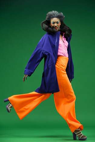 Bursting with energy: Jacket, pink silk button-down shirt and orange wide-leg pant, prices available upon request, jilsander.com. Suede espadrille sandal, Yves Saint Laurent, $795, Barneys New York, San Francisco. Photo: Russell Yip, The Chronicle