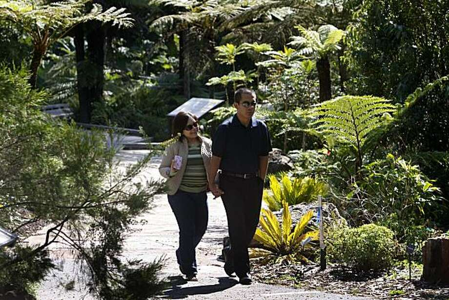 Visitors stroll through the Strybing Arboretum and botanical garden at Golden Gate Park in San Francisco, Calif. on Thursday, Sept. 9, 2010. Last month, Rec and Park officials began charging out-of-town residents a fee to enter the garden and forced city dwellers to provide proof of residency to gain free entry. Photo: Paul Chinn, The Chronicle