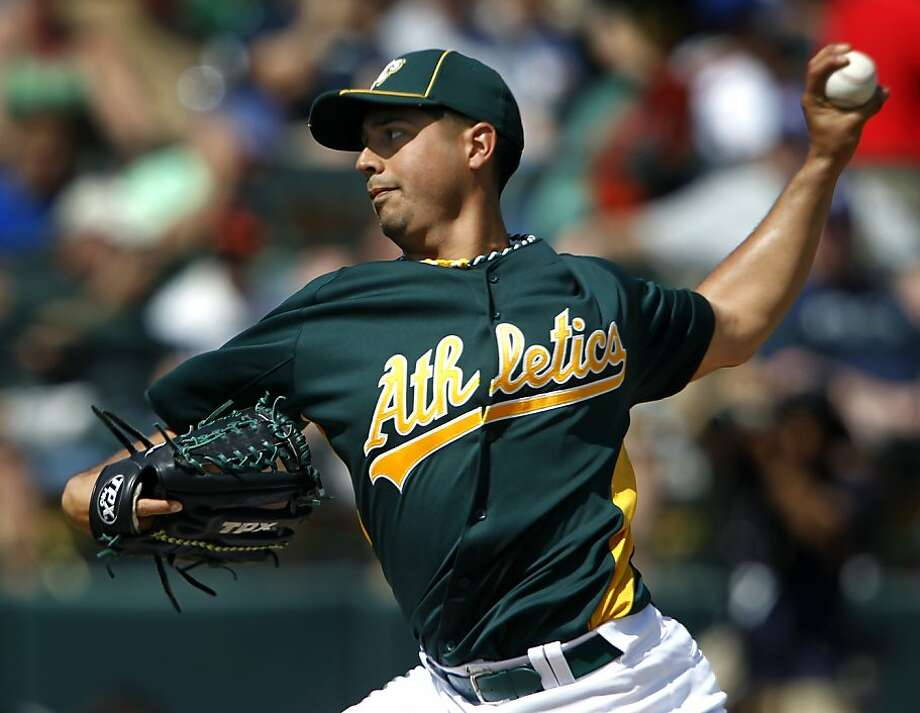 Starter Gio Gonzalez delivers a pitch in the 1st inning of the Oakland A's 6-5 win over the Chicago Cubs in a spring training baseball game at Phoenix Municipal Stadium in Phoenix, Ariz. on Thursday, March 17, 2011. Photo: Paul Chinn, The Chronicle