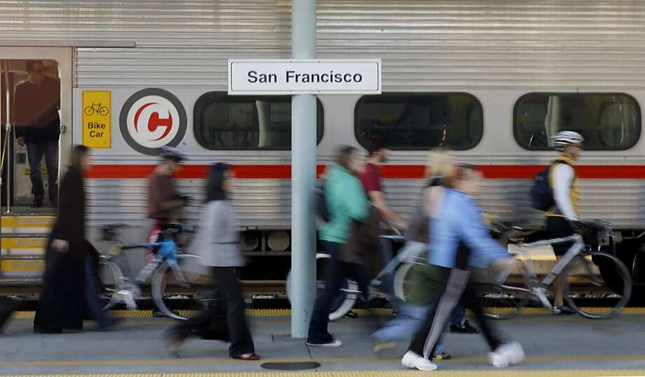 Commuters leave a train at the Caltrain station in San Francisco, Calif., on Thursday, February 19, 2009. Attempts to get more people out of their cars have fallen short, despite strong arguments from advocates who say alternatives to driving are good foCommuters leave a train at the Caltrain station in San Francisco, Calif., on Thursday, February 19, 2009. Attempts to get more people out of their cars have fallen short, despite strong arguments from advocates who say alternatives to driving are good for the environment. Ran on: 02-27-2009 Commuters disembark at the Caltrain station. The Metropolitan Transportation Commission said that in 2006, more than 10 percent of commuters used mass transit. Photo: Hardy Wilson, The Chronicle