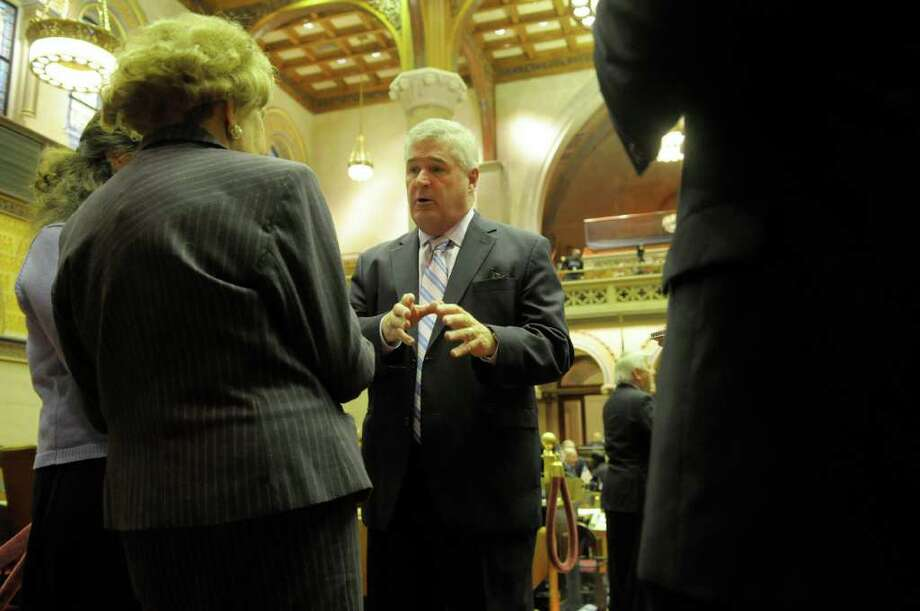 Assembly Minority Leader Brian Kolb talks to members of the media on the floor of the Assembly prior to the start of the special session called by Governor Andrew Cuomo at the capitol on Wednesday, Dec. 7, 2011 in Albany, NY.    (Paul Buckowski / Times Union) Photo: Paul Buckowski / 10015700A