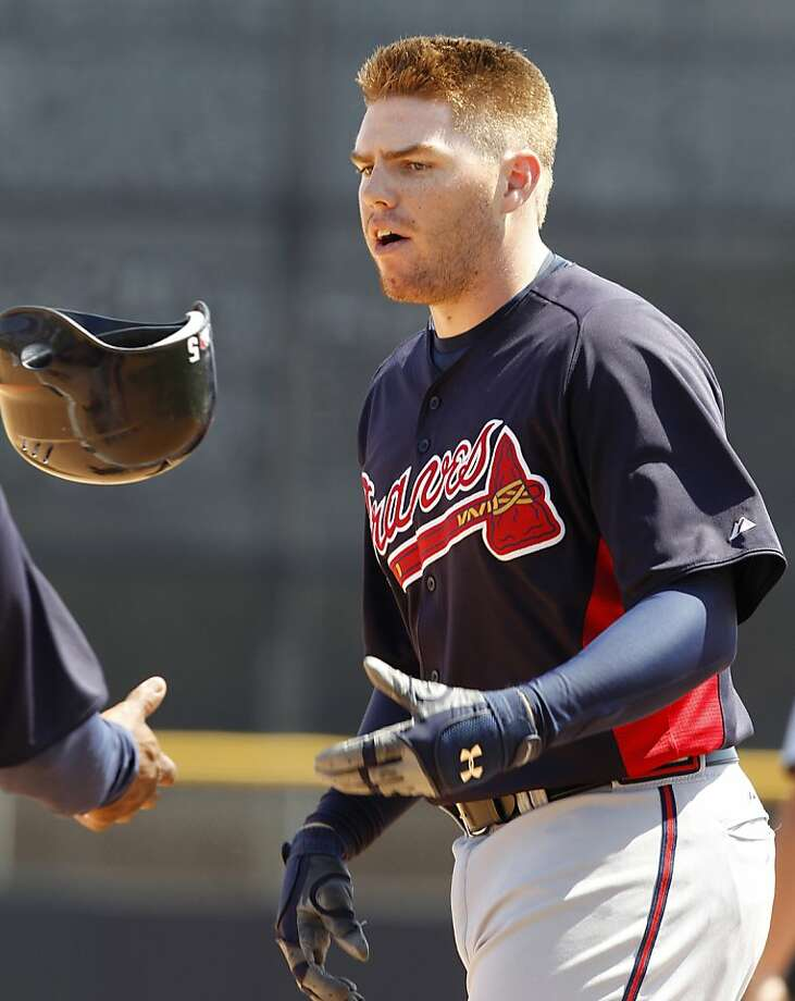 Atlanta Braves' Freddie Freeman tosses his helmet to the first base coach after grounding out in the fifth inning in their 5-3 win over the Toronto Blue Jays in a spring training baseball game at Florida Auto Exchange Stadium in Dunedin, Fla., Thursday, March 24, 2011. Photo: Kathy Willens, AP