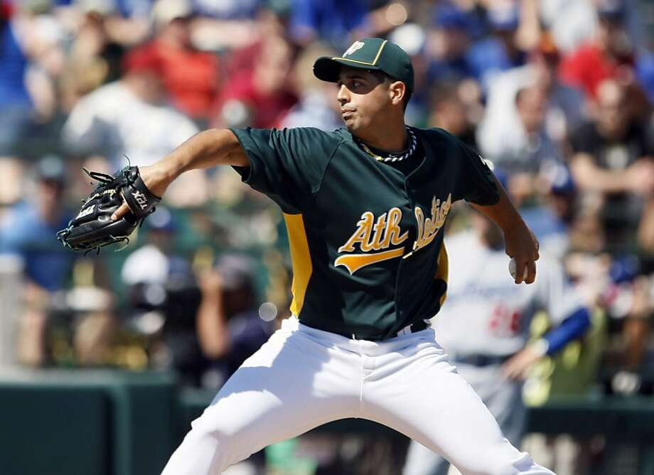 Oakland Athletics starting pitcher Gio Gonzalez throws to the Las Angeles Dodgers during the first inning of their spring training baseball game at Phoenix Municipal Stadium, Ariz. Friday, March 11, 2011. Photo: Lance Iversen, The Chronicle
