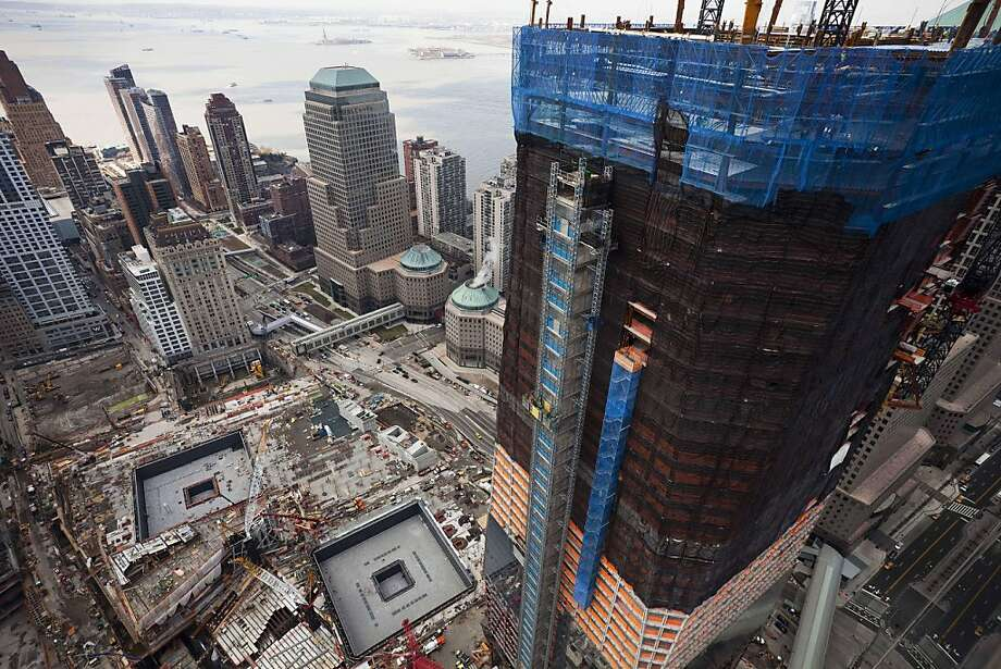 This March 15, 2011 file photo shows the Freedom Tower, right, rising above the World Trade Center site in New York. After the 9/11 attacks, there were grim predictions about the future of the shaken, dust-covered neighborhoods around the World Trade Center. Who would want to live so close to a place linked to so much disaster and despair? As it turns out, plenty of folks. Census figures released last week show that the number of people living in the area around ground zero has swelled by about 23,000 since 2000, making it one of the fastest growing places in the city. Photo: Mark Lennihan, AP