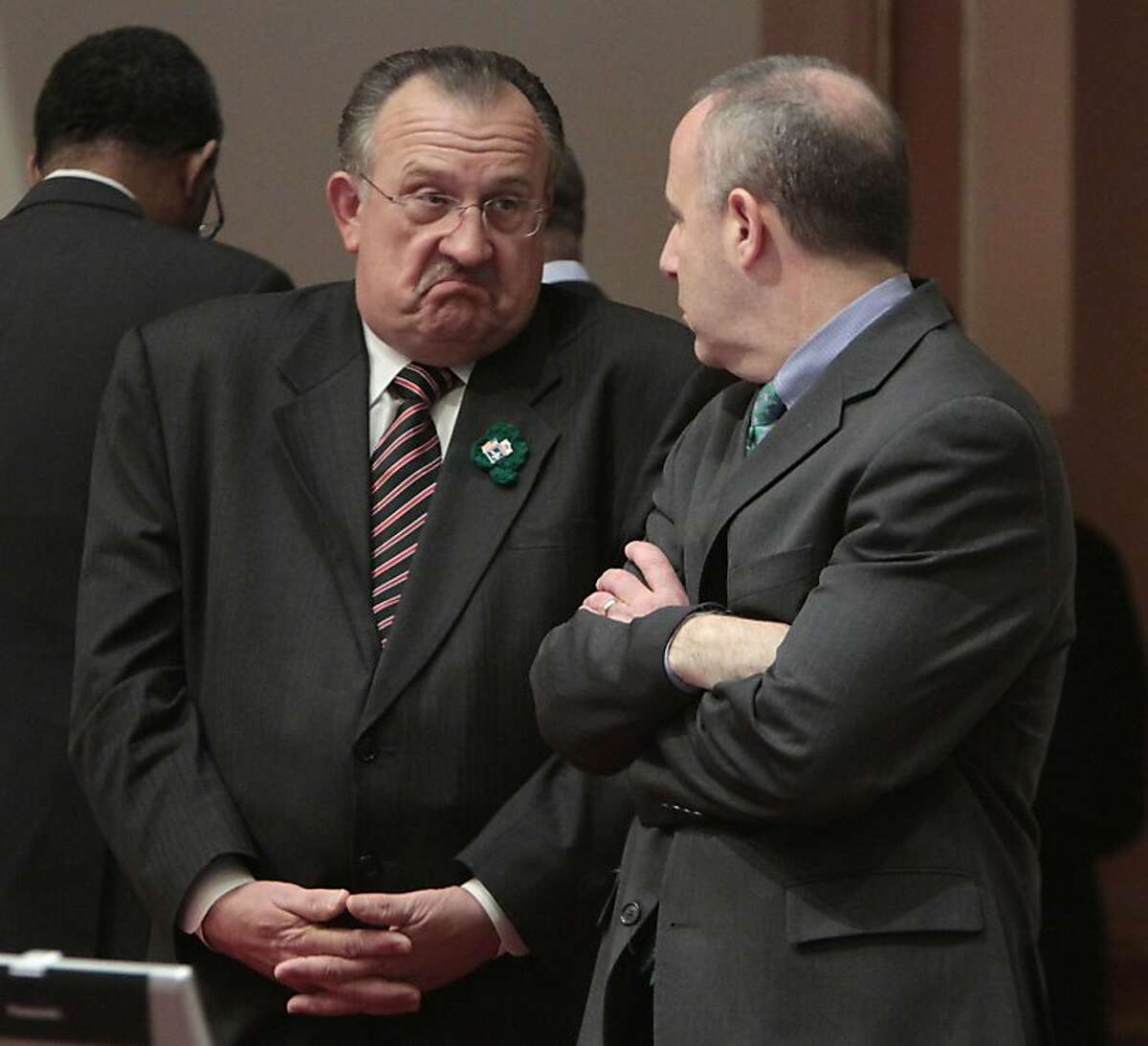 Senate Minority Leader Bob Dutton, R-Rancho Cucamonga, left, shrugs as he talks with Senate President Pro Tem Darrell Steinberg, D-Sacramento during the debate of Gov. Jerry Brown's budget package at the Capitol in Sacramento, Calif., Thursday March 17,2011. By a party-line vote, both houses of the legislature approved Brown's main budget bill but did not approve putting tax extensions before voters or eliminating redevelopment agencies.