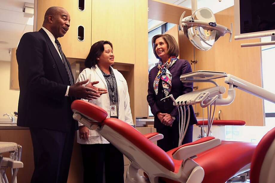 Chief executive officer Charles Range (left), and dental director Dr. Gemma Ferrer (middle) show democratic leader Nancy Pelosi (right)  the dental clinic at the South of Market Health Center in San Francisco, Calif., on Monday, March 28, 2011. Photo: Liz Hafalia, The Chronicle