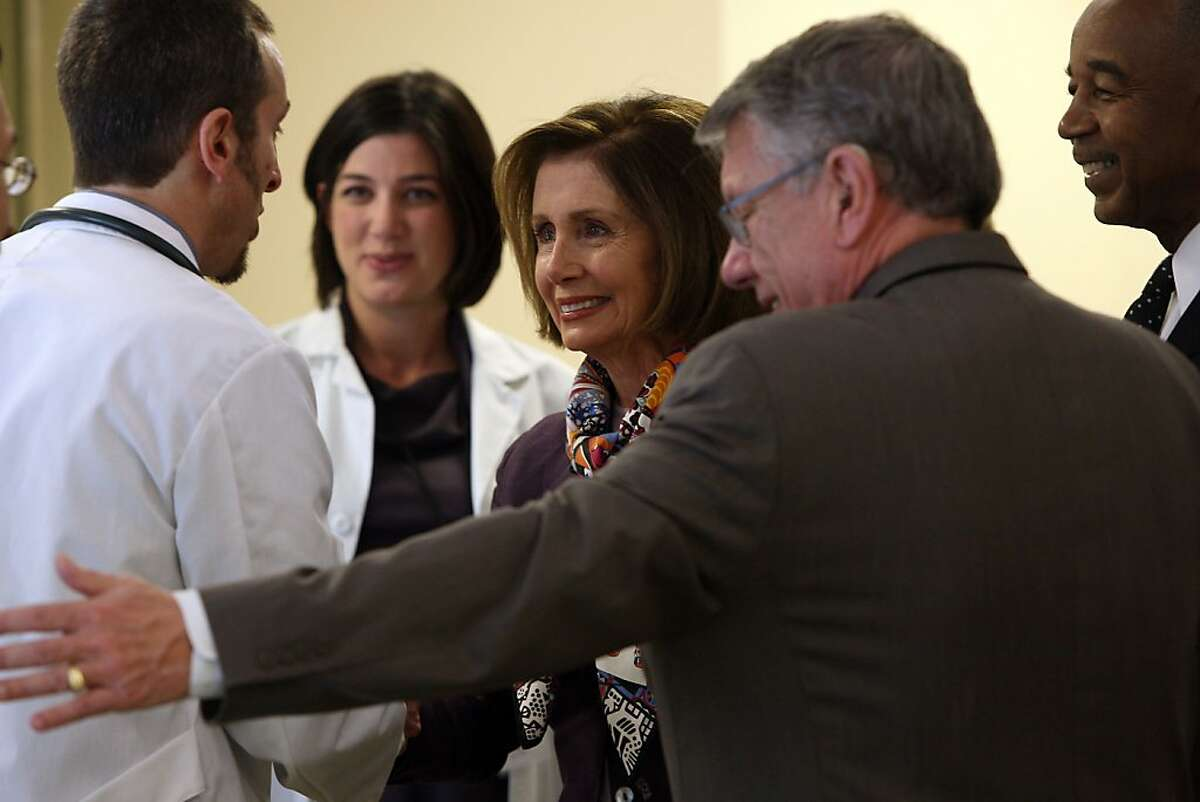 Democratic Leader Nancy Pelosi (middle) being greeted by David Lawn (left), M.D., director of nursing Elizabeth Ewing (middle, left), and chief executive officer Charles Range of the South of Market Health Center in San Francisco, Calif., on Monday, March 28, 2011.