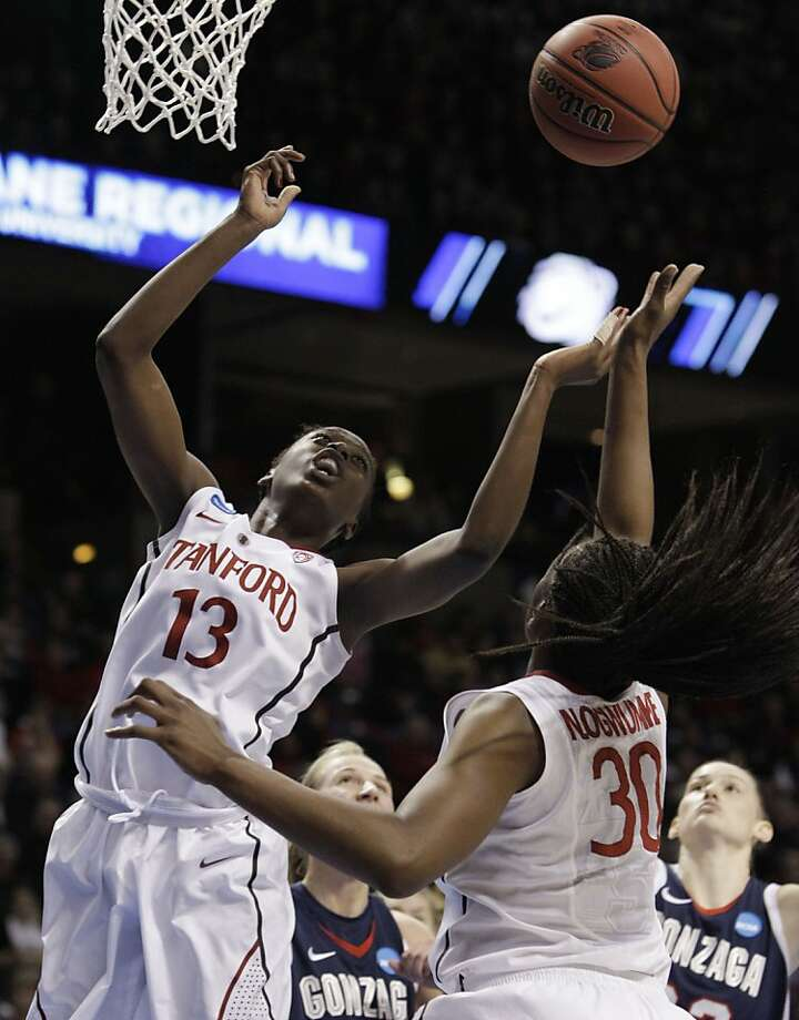 Stanford's Chiney Ogwumike (13) and Nnemkadi Ogwumike (30) reach for a loose ball against Gonzaga in the first half of an NCAA women's college basketball tournament regional final, Monday, March 28, 2011, in Spokane, Wash. Photo: Elaine Thompson, AP