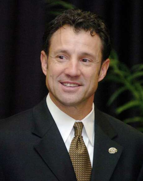 Larry Fedora, 45, waits to speak to the large crowd gathered after being named the head football coach at Southern Miss, Wednesday, Dec. 12, 2007, in Hattiesburg, Miss. Fedora was the offensive coordinator at Oklahoma State. (AP Photo/Steve Coleman) Photo: Steve Coleman / AP