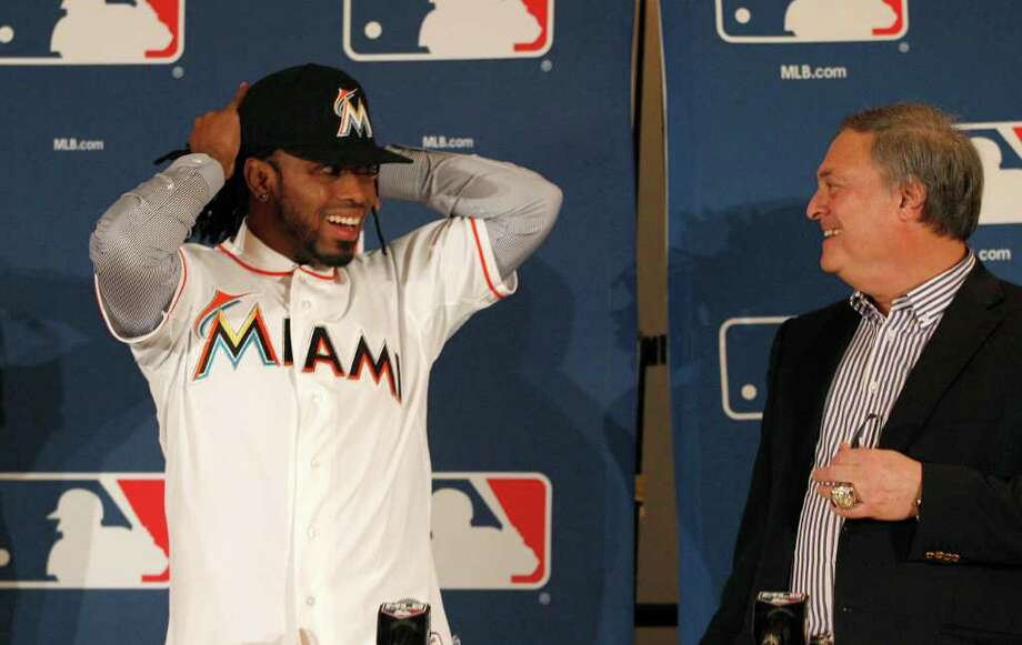 LM OTERO: ASSOCIATED PRESS EXPENSIVE CATCH: Owner Jeffrey Loria, right, was able to get Jose Reyes into the Marlins' new uniforms for a price - $106 million over six years. Photo: LM Otero / AP