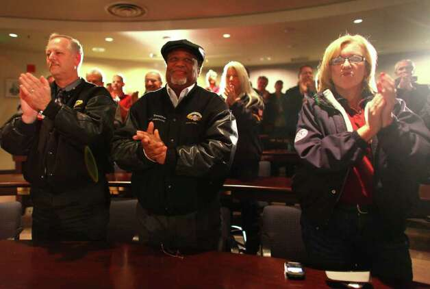Union members applaud the announcement that members approved a contract extension with Boeing at the International Aerospace Machinists Union Hall in Seattle on on Wednesday, Dec. 7, 2011. Photo: JOSHUA TRUJILLO / SEATTLEPI.COM