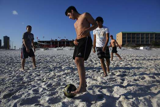 PENSACOLA BEACH, FL - MARCH 10: People play soccer on the beach March 10, 2011 in Pensacola Beach, Florida. With spring break approaching, crews continued to work to remove leftover oil from last spring's Deepwater Horizon oil spill from beaches along theGulf Coast. Photo: Eric Thayer, Getty Images