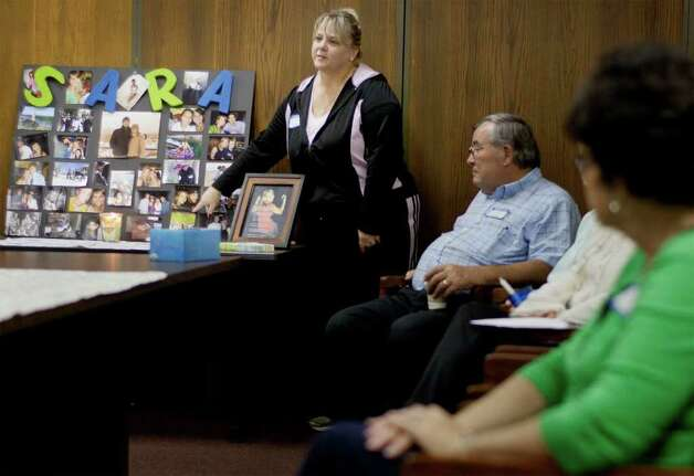 Donna Solarczyk (left) speaks about her daughter, Sara, during a meeting of The Compassionate Friends support group on Thursday, Dec. 1, 2011. Photo: Darren Abate, For The Express-News