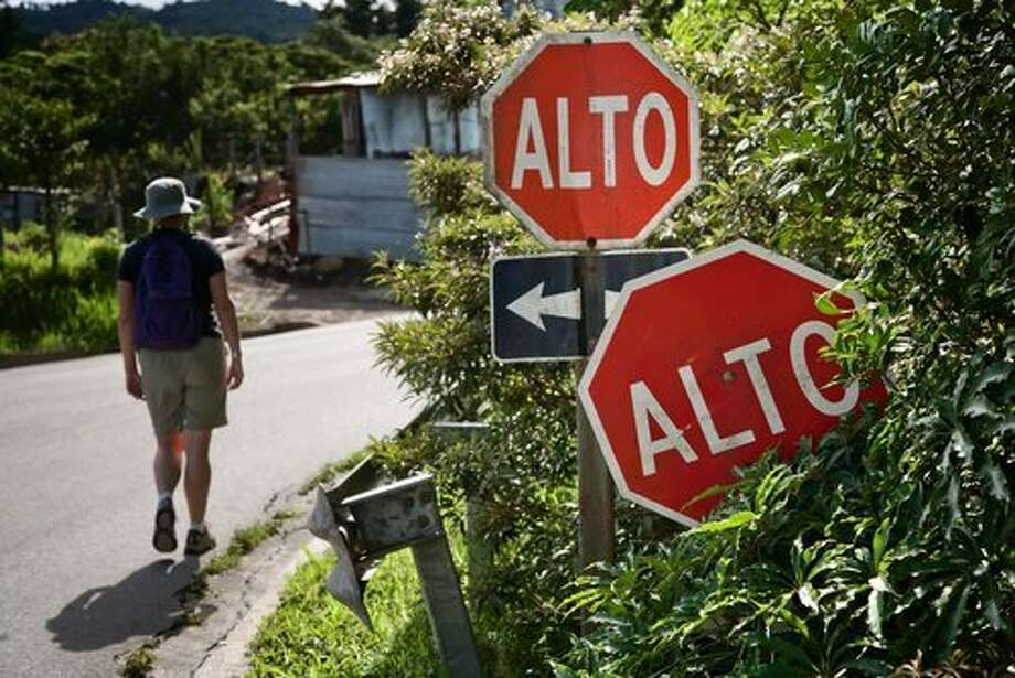Alto (stop), obvious by the red hexagonal sign even if you don't know the word. Photo: Craetista, Shutterstock