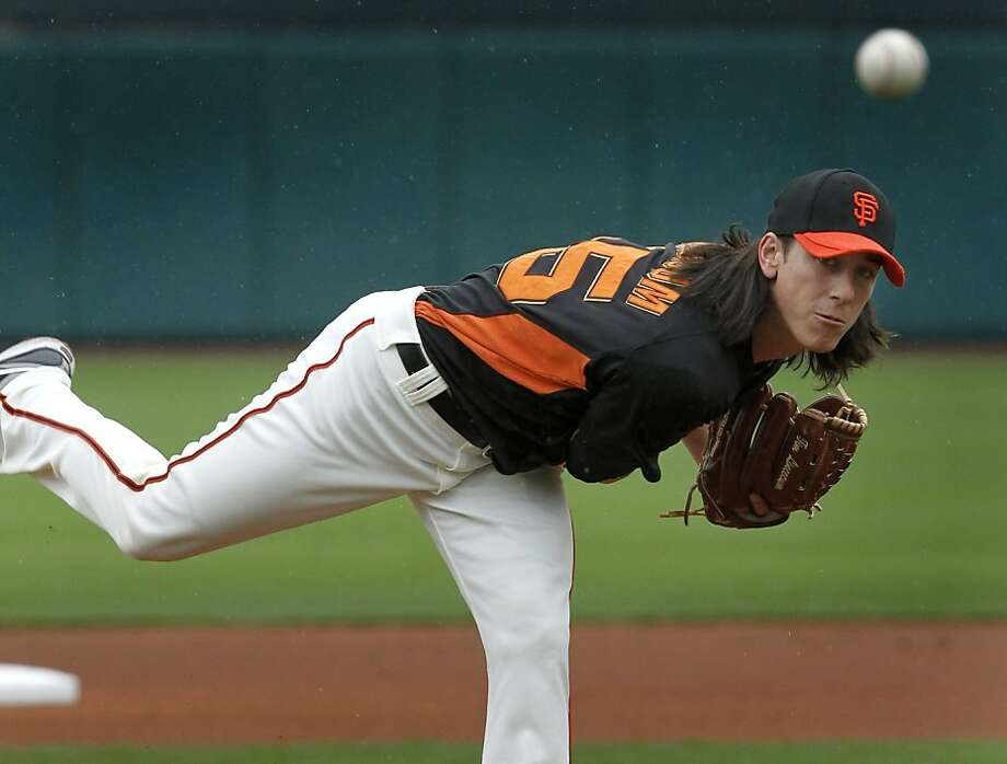 Tim Lincecum warms up before the 1st inning of the Giants spring training baseball game against the Colorado Rockies that was cancelled in the 3rd inning because of rain at Scottsdale Stadium in Scottsdale, Ariz. on Monday, March 21, 2011. Photo: Paul Chinn, The Chronicle