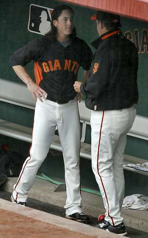 Tim Lincecum has a chat with pitching coach Dave Righetti after Lincecum was yanked from the Giants spring training baseball game against the Colorado Rockies at Scottsdale Stadium in Scottsdale, Ariz. on Monday, March 21, 2011. The game was called off after a rain delay in the 3rd inning. Photo: Paul Chinn, The Chronicle
