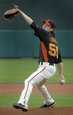 Tim Lincecum's brief appearance was less than stellar before the Giants spring training baseball game against the Colorado was cancelled in the 3rd inning because of rainy and wet conditions at Scottsdale Stadium in Scottsdale, Ariz. on Monday, March 21, 2011. Photo: Paul Chinn, The Chronicle