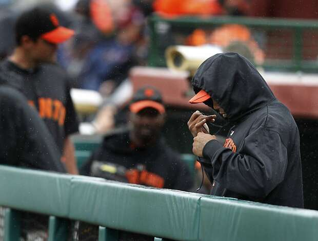 Darren Ford bundles up before the Giants spring training baseball game against the Colorado Rockies was cancelled in the 3rd inning because of rainy and wet conditions at Scottsdale Stadium in Scottsdale, Ariz. on Monday, March 21, 2011. Photo: Paul Chinn, The Chronicle