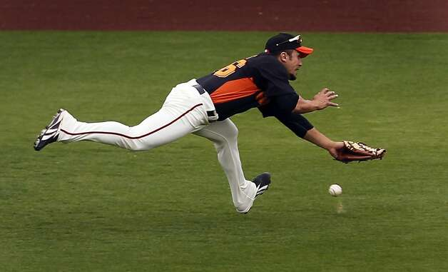 Andres Torres dives for Chris Anderson's drive, which fell for a triple, in the eighth inning of the Oakland A's 6-4 win over the San Francisco Giants in a spring training game at Scottsdale Stadium in Scottsdale, Ariz., on Sunday. Photo: Paul Chinn, The Chronicle