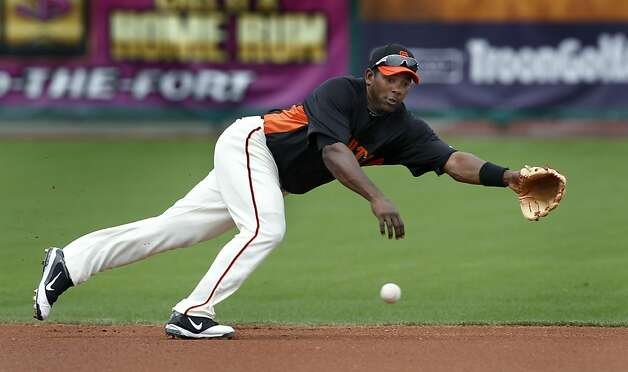 Miguel Tejada's diving attempt can't stop a grounder by Cliff Pennington, which got through for a single in the first inning of the Oakland A's 6-4 win over the San Francisco Giants in a spring training game at Scottsdale Stadium in Scottsdale, Ariz., on Sunday. Photo: Paul Chinn, The Chronicle