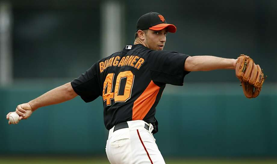 Madison Bumgarner surrendered four runs on four hits in two innings of work in the Oakland A's 6-4 win over the San Francisco Giants in a spring training game at Scottsdale Stadium in Scottsdale, Ariz., on Sunday. Photo: Paul Chinn, The Chronicle