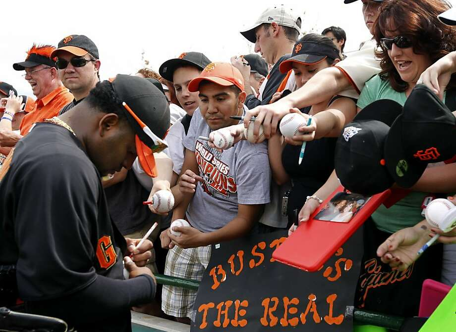 First-time spring training Giants fan Tommy Magallanes (center) seeks an autograph from Pablo Sandoval before the Giants game against the Milwaukee Brewers at Scottsdale Stadium in Scottsdale, Ariz. on Monday, March 14, 2011. Photo: Paul Chinn, The Chronicle
