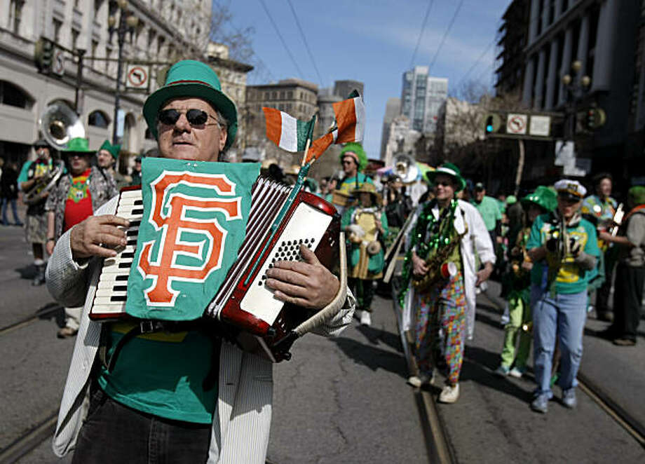 The Los Trancos Woods Community Marching Band plays its way down Market Street during the St. Patrick's Day parade in San Francisco on Saturday. Photo: Thomas Levinson, The Chronicle