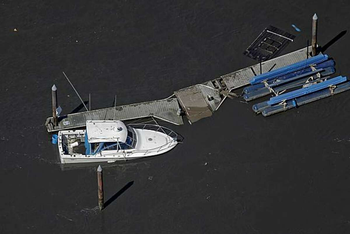 A boat is partially submerged at the Santa Cruz Harbor in Santa Cruz, Ca., on Friday March, 11, 2011, following the aftermath of the hugh Japan earthquake which triggered a tsunami that reached the West Coast of California today.