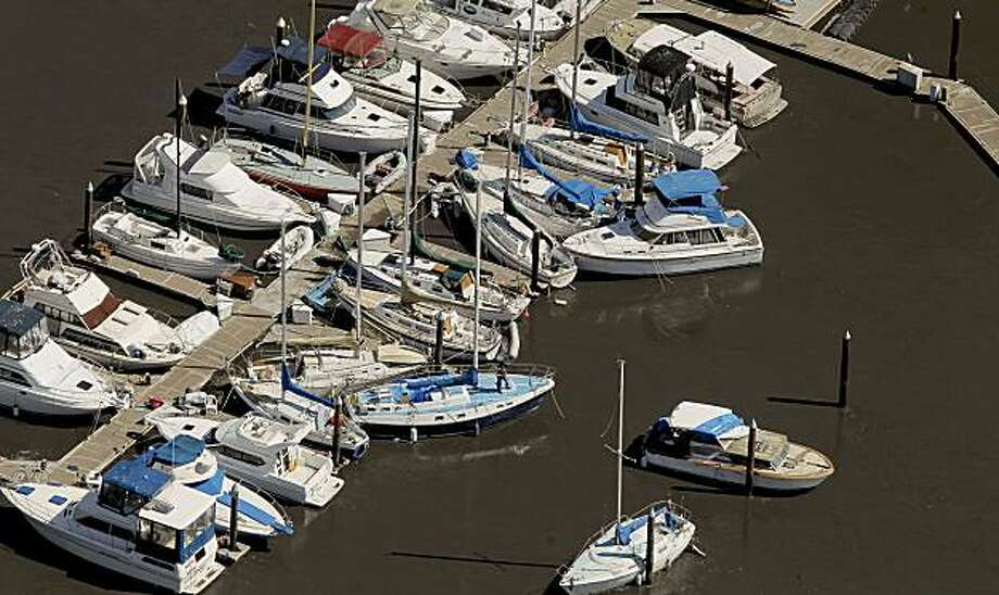 Boats are jammed into each other at the Santa Cruz Harbor in Santa Cruz, Ca., on Friday March, 11, 2011, following the aftermath of the hugh Japan earthquake which triggered a tsunami that reached the West Coast of California today. Photo: Michael Macor, The Chronicle