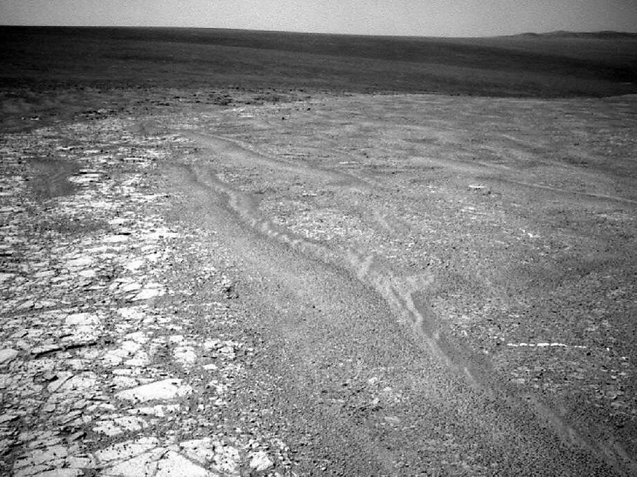 This image provided by NASA shows a fragment along the rim of Endeavour Crater where the Mars rover Opportunity has been exploring since August. With Martian winter approaching, Opportunity has been in search of a spot to spend the winter. (AP Photo/NASA) Photo: AP