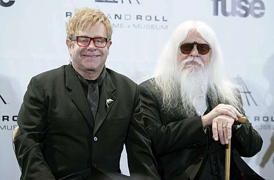 Elton John, left, and Leon Russell appear backstage at the Rock and Roll Hall of Fame induction ceremony, Monday, March 14, 2011, in New York. Photo: Ap, AP
