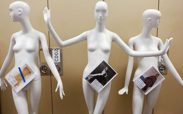 Information labels hang on mannequins that will be used in the Cristobal Balenciaga show at the de Young Museum on Friday, March 11, 2011 in San Francisco, Calif.  The labels contain information about which articles of clothing will be placed on the manneInformation labels hang on mannequins that will be used in the Cristobal Balenciaga show at the de Young Museum on Friday, March 11, 2011 in San Francisco, Calif.  The labels contain information about which articles of clothing will be placed on the mannequin. Photo: Russell Yip, The Chronicle