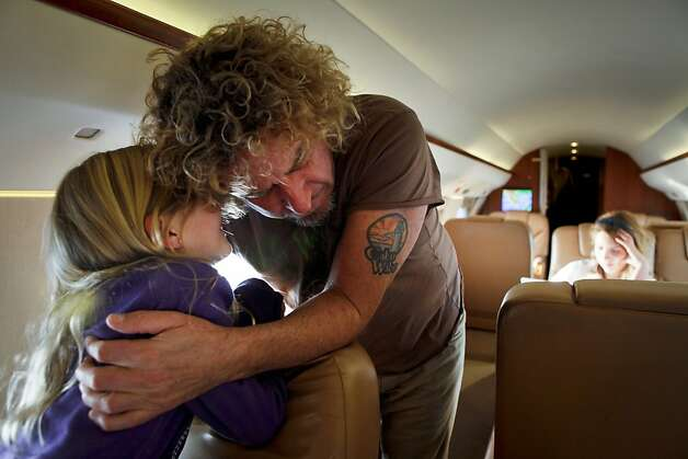 Samantha Hagar, 9, whispers into her father's, Sammy, ear prior to landing in Cabo San Lucas, Mexico, for a family vacation on Friday, Feb. 18, 2011. Photo: Russell Yip, The Chronicle