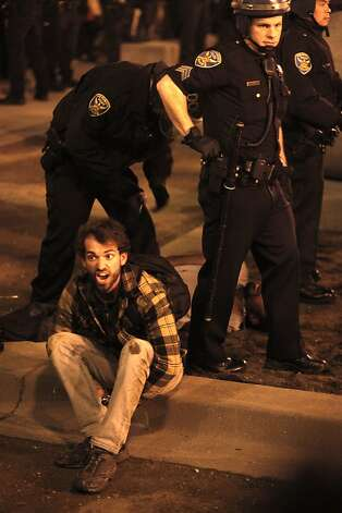 San Francisco police officers arrest a few of the protesters, as the Occupy SF group rallies and tries to take back their encampment at Justin Herman Plaza in San Francisco, Ca., on Wednesday December 7, 2011. Photo: Michael Macor, The Chronicle